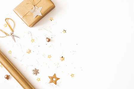 Christmas composition. Gift box, golden decorations on white background. Christmas, winter, new year concept. Flat lay, top view