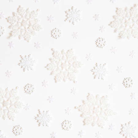 Christmas composition. Frame made of white snowflakes on white background. Christmas, winter, new year concept. Flat lay, top view