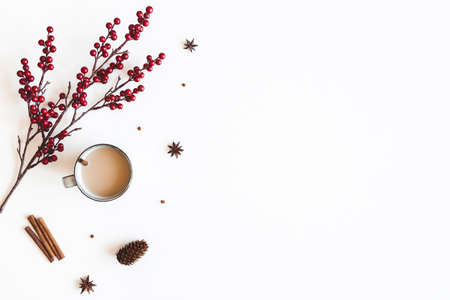 Autumn composition. Cup of coffee, berries on white background. Christmas, winter concept. Flat lay, top view