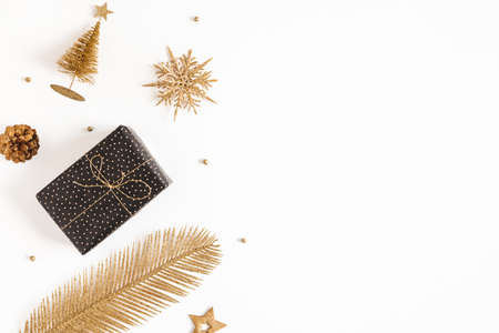 Christmas composition. Gift boxes, black and golden decorations on white background. Christmas, winter, new year concept. Flat lay, top view, copy space