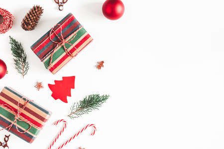 Christmas composition. Christmas gifts, fir tree branches, decorations on white background. Flat lay, top view, copy space Stock fotó