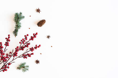 Christmas composition. Red berries, fir branches on white background. Christmas, winter, new year concept. Flat lay, top view Stock fotó