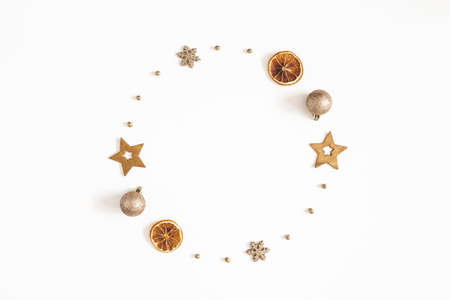 Christmas composition. Wreath made of golden decorations on white background. Christmas, winter, new year concept. Flat lay, top view