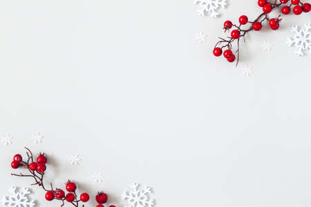 Christmas or winter composition. Snowflakes and red berries on gray background. Christmas, winter, new year concept. Flat lay, top view Stock fotó