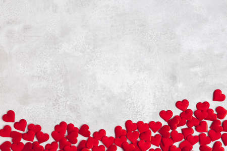 Valentine's Day background. Red hearts on concrete gray background. Valentines day concept. Flat lay, top view, copy space