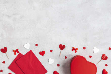 Valentine's Day background. Gift, envelope, hearts on concrete gray background. Valentines day concept. Flat lay, top view