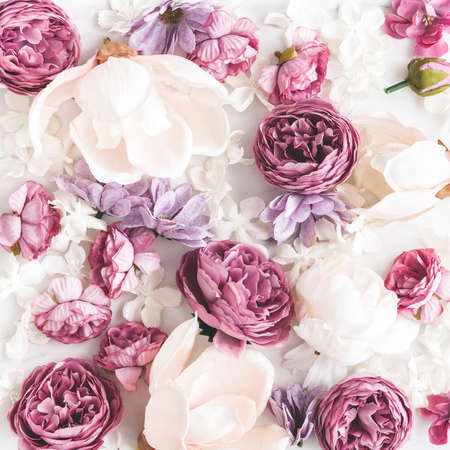 Flowers composition. White and purple flowers on marble background. Flat lay, top view 写真素材