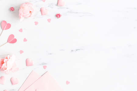 Valentine's Day background. Pink flowers, envelope, hearts on marble background. Valentines day concept. Flat lay, top view 写真素材