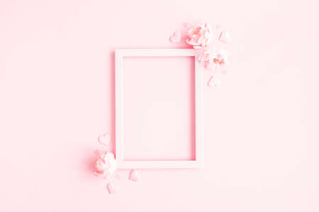 Valentine's Day background. Photo frame, pink flowers, hearts on pastel pink background. Valentines day concept. Flat lay, top view, copy space 写真素材