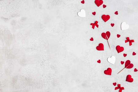 Valentine's Day decorations on concrete gray background. Valentines day concept. Flat lay, top view 写真素材