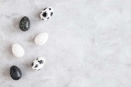Easter eggs on concrete gray background. Easter concept. Flat lay, top view 写真素材