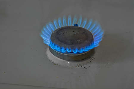 cookers: view on the blue flames of kitchen stove
