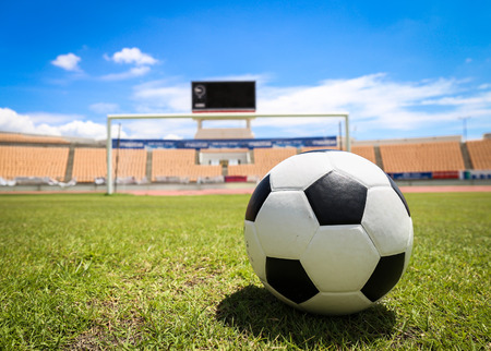 A soccer ball in front of goal photo