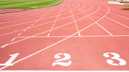 numbering: Red treadmill at the stadium with the numbering from one two three Stock Photo