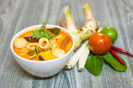 yum: Tom Yum Kung-Thai spicy soup with Herb set of Tom Yum Soup Ingredients on wood background