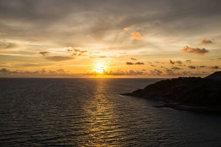 thep: Sunset over sea at Laem Phrom Thep Phuket Thailand Stock Photo
