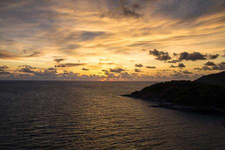 thep: Sunset over sea at Laem Phrom Thep Phuket Thailand Stock Photo