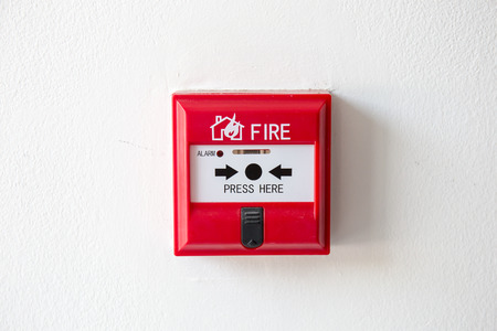 sprinkler alarm: Push button switch fire alarm box on cement wall for warning and security system