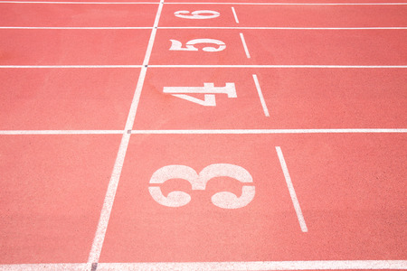 numbering: Red treadmill at the stadium with the numbering from three fourth five six