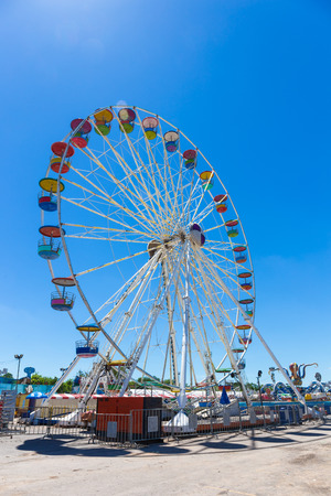 Giant ferris wheel in Amusement park with blue sky background Stock fotó