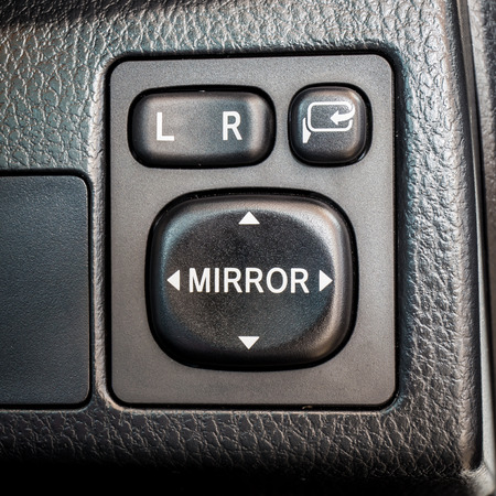 electrical equipment: Switch button adjust or controls side mirrors in a car