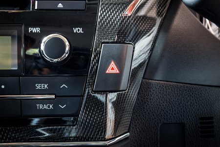 car emergency light button in interior details modern car Stock Photo