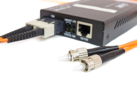 cable red: Close up metal fiber optic cable In front media converter
