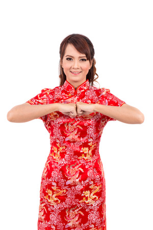 chipao: Asian Chinese girl greeting in Traditional Chinese, chinese new year
