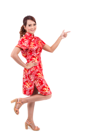 chipao: Asian Chinese girl greeting in Traditional Chinese , chinese new year, enjoy, happy