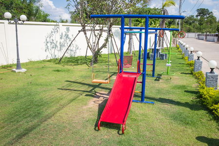 playground equipment: Colorful childrens playground in village