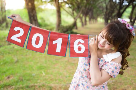 hand holding paper: smile of cute woman hand holding paper sign 2016, happy new year