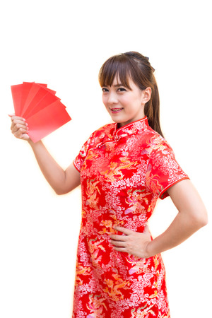 pow: Happy chinese new year,Cute smiling Asian woman dress traditional cheongsam and qipao holding red envelopes ang pow or red packet monetary gift card on white isolated background