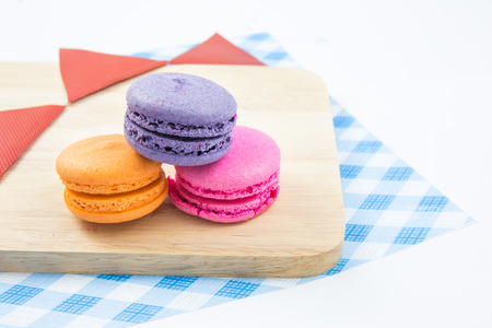 resentation: Colorful macaroons variety closeup on wood. concept resentation