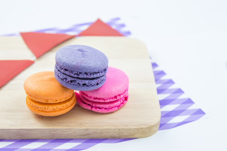Colorful macaroons variety closeup on wood. concept resentation