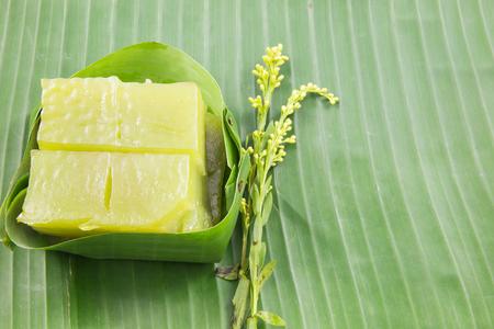 sweetmeat: Kind of Thai sweetmeat, Multi Layer Sweet Cake (Kanom Chan) on banana leaf with flower