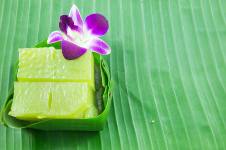chan: Kind of Thai sweetmeat, Multi Layer Sweet Cake (Kanom Chan) on banana leaf with orchid flower Stock Photo
