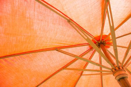 parasol: Orange parasol or umbrella background. Stock Photo