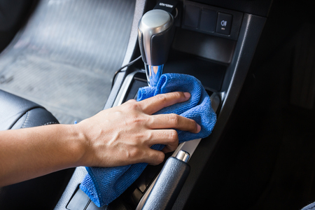 hand brake: Hand with microfiber cloth cleaning Interior modern car.