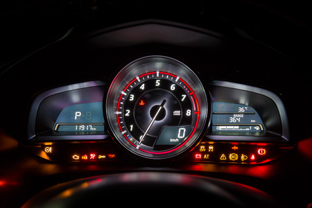 rev: Modern car instrument dashboard panel or speedometer and full symbol in night time