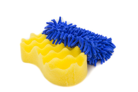 Yellow sponges and blue mitts for washing car on white background