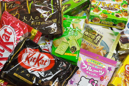 TOKYO, JAPAN - FEBRUARY 14, 2016: Japanese Sweets Snack in Narita airport duty free shop green tea matcha, sakura-matcha, and chocolate Kit Kat, Hello Kitty, Lotte is most popular for tourist Editorial