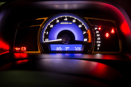 Modern car instrument dashboard panel in night time Stock fotó