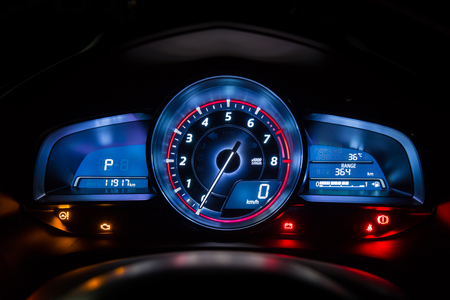 night shift: Modern car instrument dashboard panel or speedometer in night time