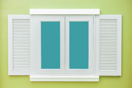 light green wall: White window classic vintage on the color light green wall background