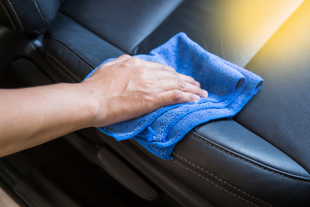 microfiber cloth: Hand with microfiber cloth cleaning Interior modern car.