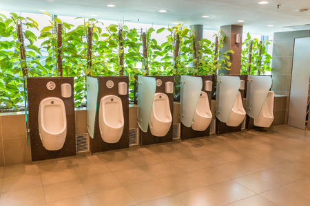 public men toilet room with technology electronic sensor and green plant for relax Stock Photo