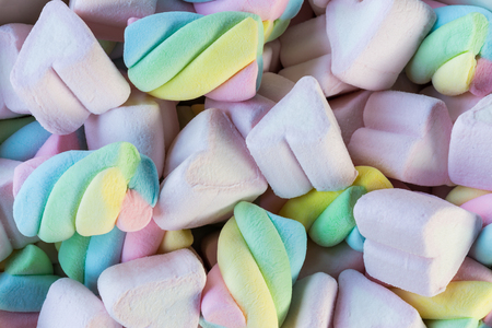 Closeup of colorful mini marshmallows background or texture. Stock Photo