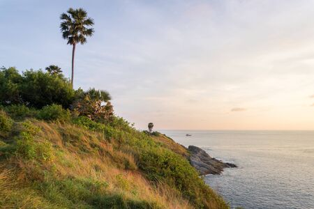 View point, sunset at Phrom thep cape or Laem Phrom thep is symbol Phuket island, Thailand. Most popular in vacation or holiday for tourism and famous. Stock Photo