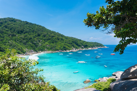 Beautiful view point with blue sky and clouds, blue sea and white sand beach with boat on Similan island, No.8 at Similan national park, Phuket, Thailand is most popular vacation for tourist.