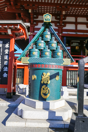 TOKYO, JAPAN - NOVEMBER 19, 2014: Sensoji Temples sacred tank in the Asakusa District. Senso-ji was founded in 628 AD and is one of the most well known temples in the country.